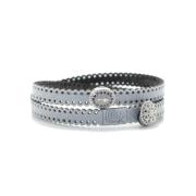 Braccialetto religioso in tessuto colore argento metallizzato.Inserto e chiusura in Argento 925% con zirconi blu.