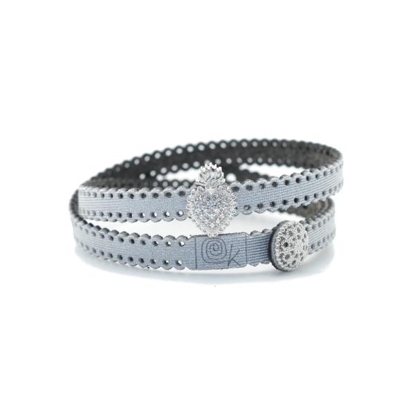 Bracciale in tessuto metallizzato colore argento con inserto religioso in argento 925%.100% made in Italy