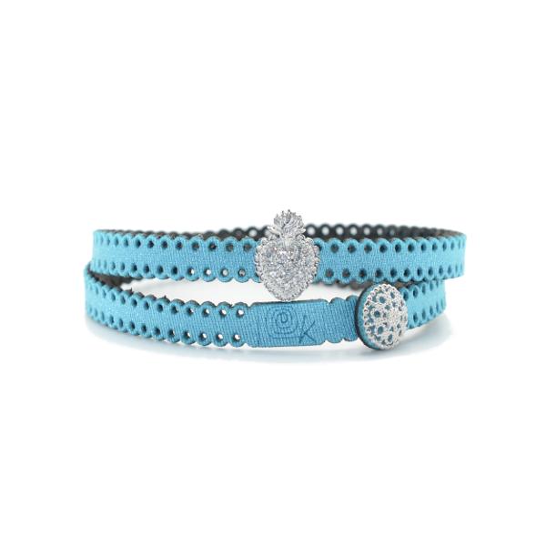 Bracciale in tessuto metallizzato colore azzurro con inserto religioso in argento 925%.100% made in Italy