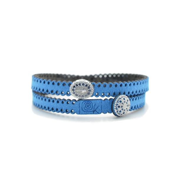 Braccialetto religioso in tessuto colore baia metallizzato.Inserto e chiusura in Argento 925% con zirconi blu.