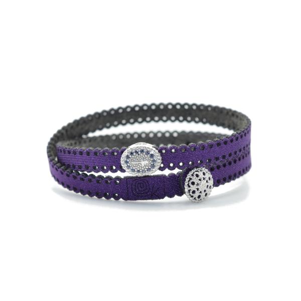 Braccialetto in tessuto viola con inserto croce in argento 925 e zirconi blu. 100% made in Italy